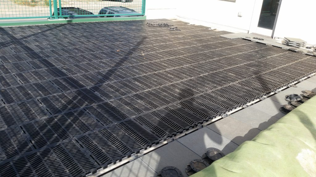 Here's the completed hog-slat flooring installation prior to rolling the turf back out.  The slatted panels are perfect for letting water drain down through the turf and then let the roofing below do the reast of the work.