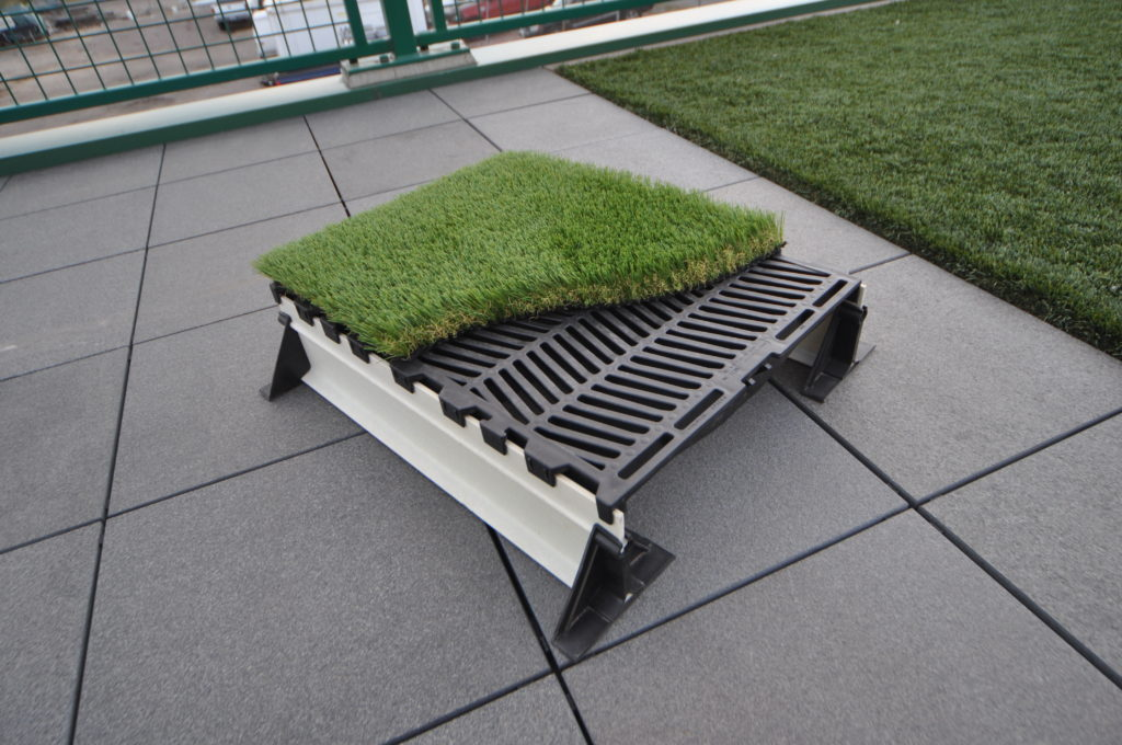 Mock-up sample of the sytem.  We actually put this together, not only to show the various components of the system, but also to mock up a test of a system for high wind areas.  This doubled as a test for adhering the turf to the hog slats. No we just need a project to test it on!